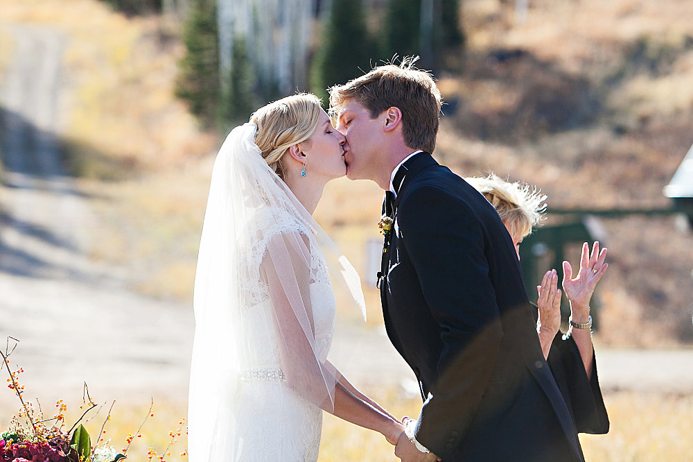 the bride and groom's first kiss and husband and wife